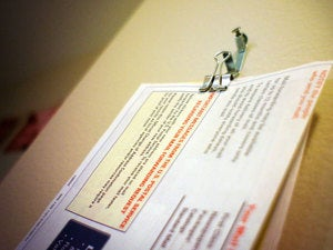 Easily Sort Your Snail Mail with Binder Clips and Wall Hooks