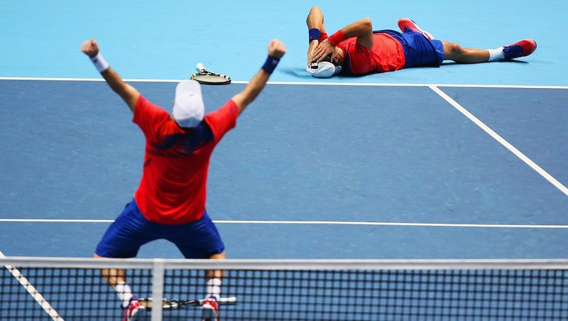 The Jubilance And Trauma Of Victory Displayed On One Tennis Court