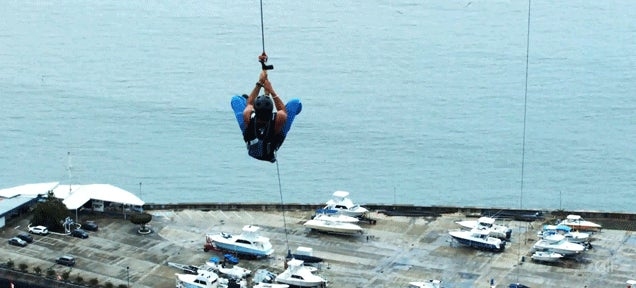Mad guys ride the largest and most insane urban zip-line in the world