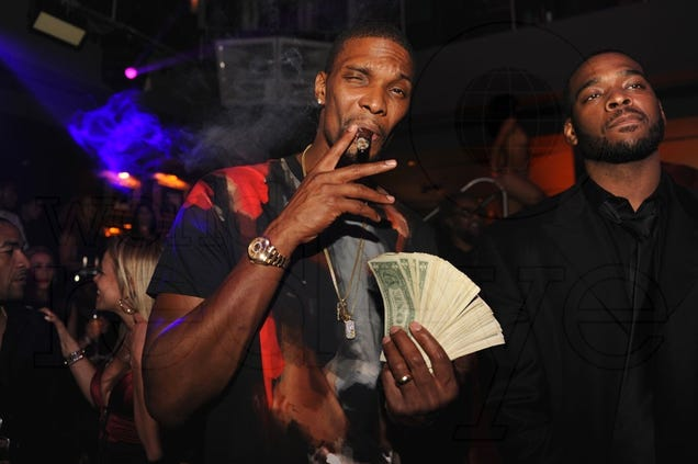 Chris Bosh smoking a cigarette (or weed)