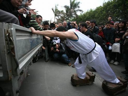 Chinese Ripoff Beijing Olympics in Kung Fu Truck Push