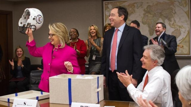 Hillary Clinton Returns to State Department, Gets Protective Headgear from Employees