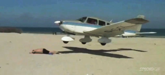 Plane almost lands on guy who was sunbathing on a beach in Germany