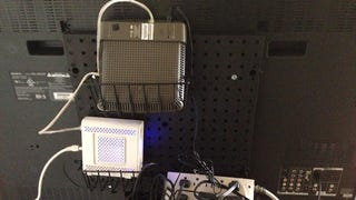 Attach a pegboard on the back of your flat screen