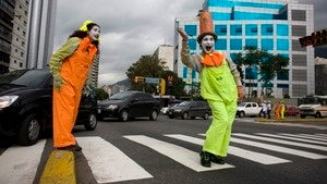 City hires army of mimes to fight traffic