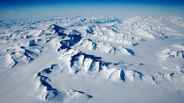 How did a giant mountain range form beneath a mile of Antarctic ice?