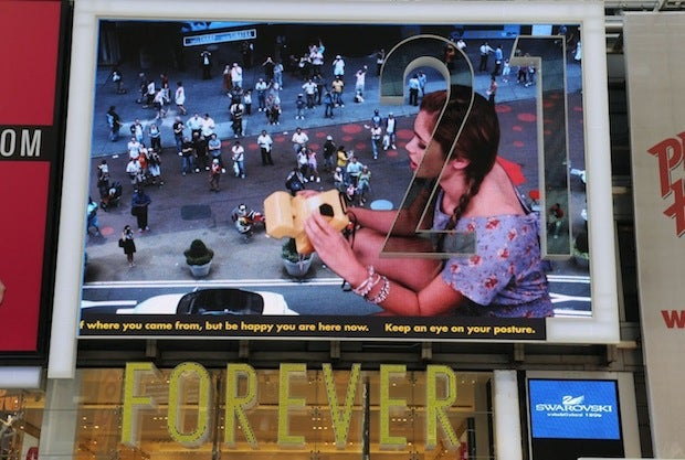 50-Foot Models Invade Times Square Billboard With Polaroids And Kisses