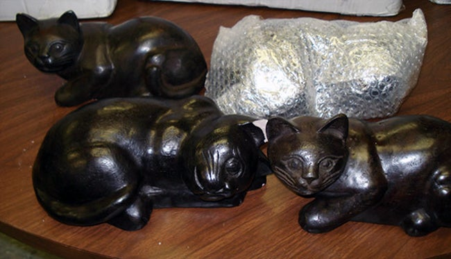 Kitty Statues Hid Epic Opium Stash