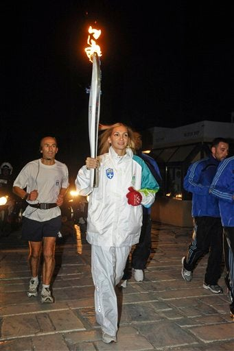 Olympic Torch Carried By Athlete On Steroids
