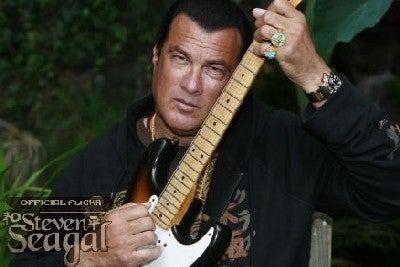 Some Pictures of Steven Seagal Playing Guitar