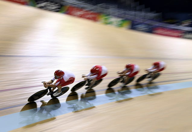 England's cycling team, led by Bradley Wiggins, trains in a velodrome in Glasgow, Scotland, Tuesday.