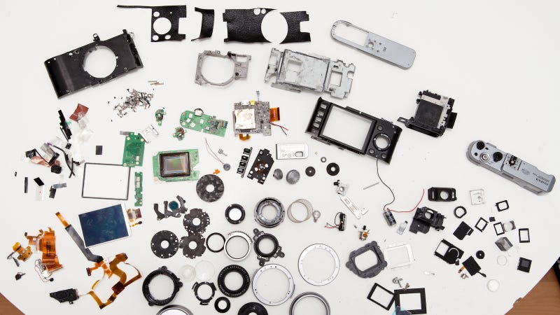 How Many Screws Does It Take to Get to the Center of an Exploded Fuji X100?