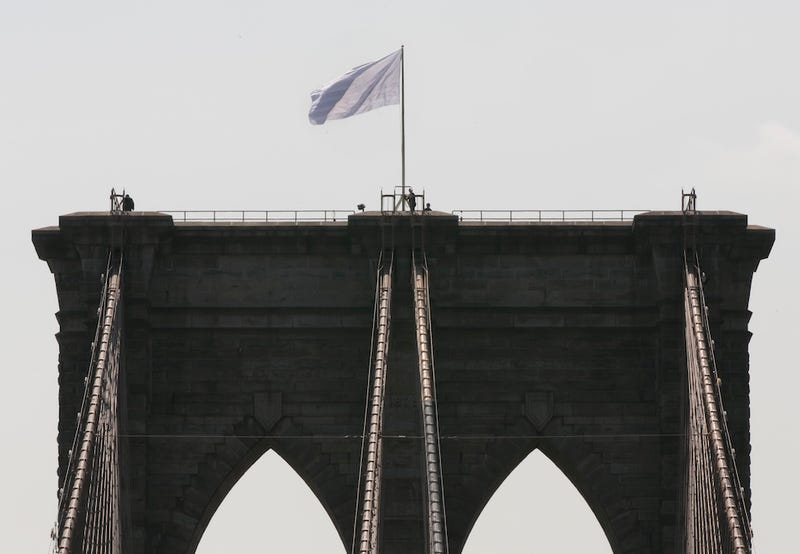 Why Not Tell Us Your Theory About the Brooklyn Bridge's White Flags?