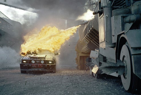 New Death Race Stills: Flame Throwing, Jag Destroying And Overacting Galore