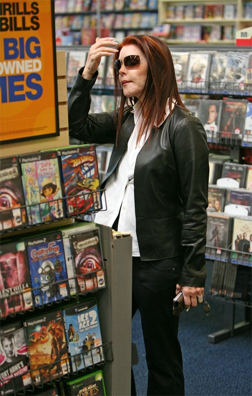 Priscilla Presley Does Her Hair In Drama Aisle