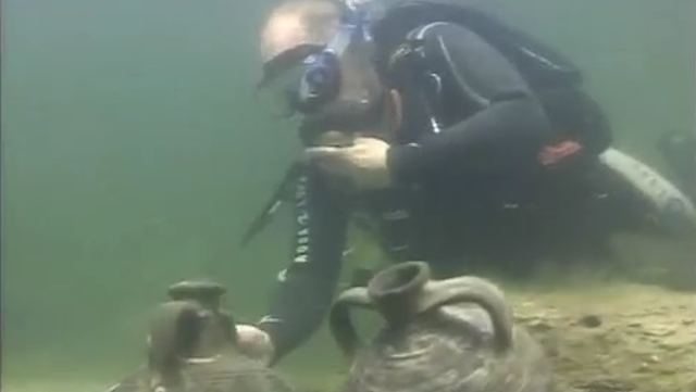 Vladimir Putin Casually Discovers a Pair of 6th Century Artifacts While Scuba Diving