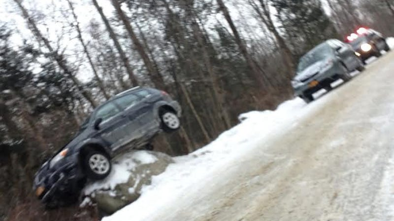 What Happened To This Poor Little Pontiac Perched So Precariously?