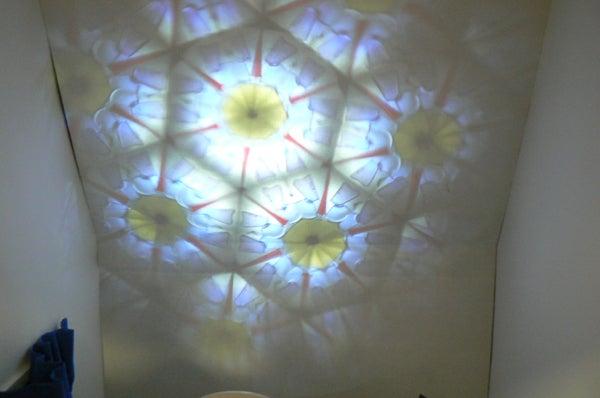 Japanese Mangekyo Kaleidoscope Projector: A Haiku
