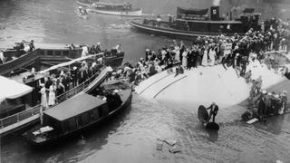 Found this photo of a 1915 ferry accident on the Chicago River. Check out the guy standing nonchalantly on the propeller. (next time take the bus)