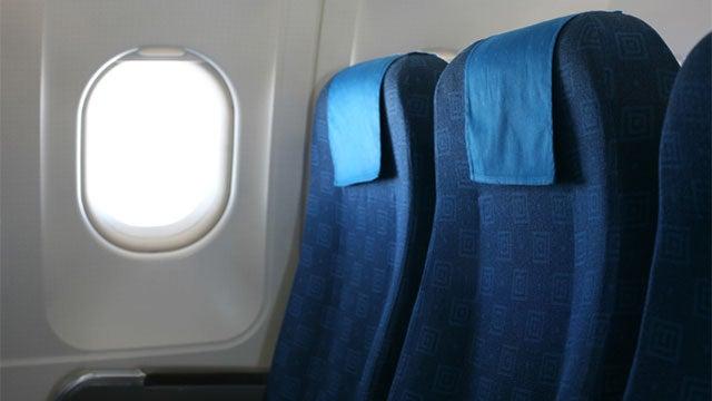 Airplane Armrest Turf War Leads to Threats of Throat-Slashing