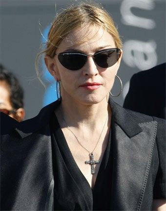 Madonna's Visit To Disaster Victims Brought To You By Dior!