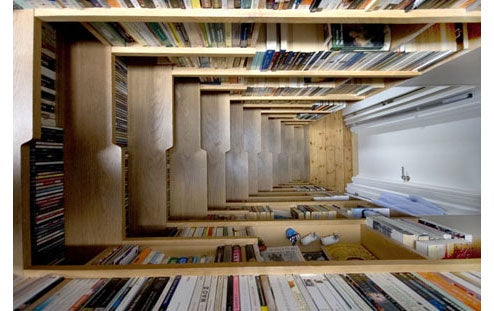 Staircase Bookshelf Does Double Duty