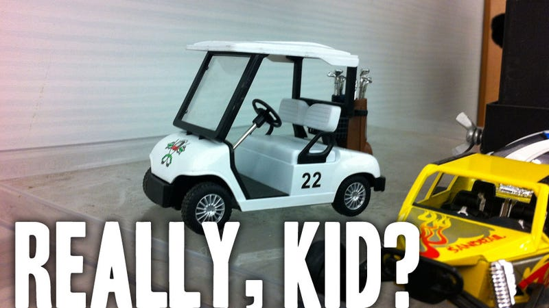 What Kid Is Picking The Golf Cart Toy?
