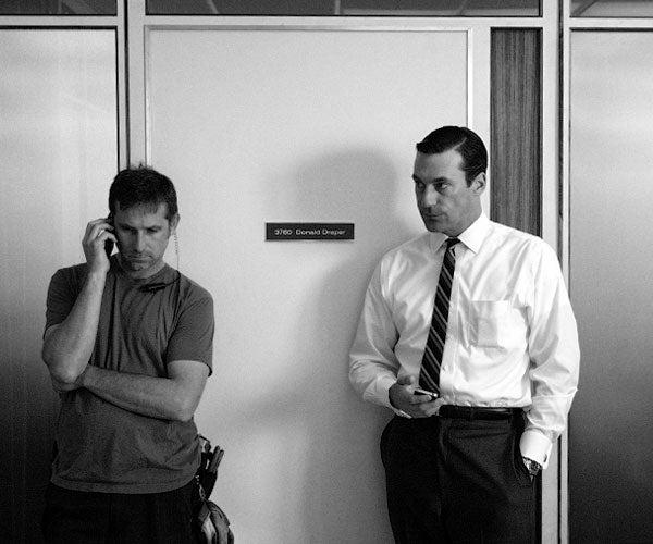 Don Draper Checks His iPhone