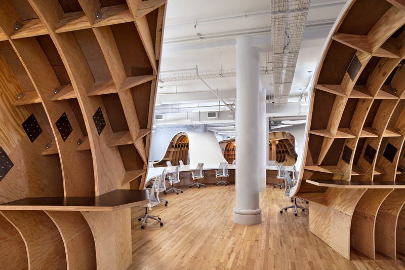 This gorgeous office has an endless desk made by robots