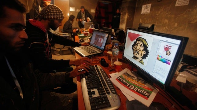 Libya Protestors Using Photoshop to Make Caricatures of Gaddafi