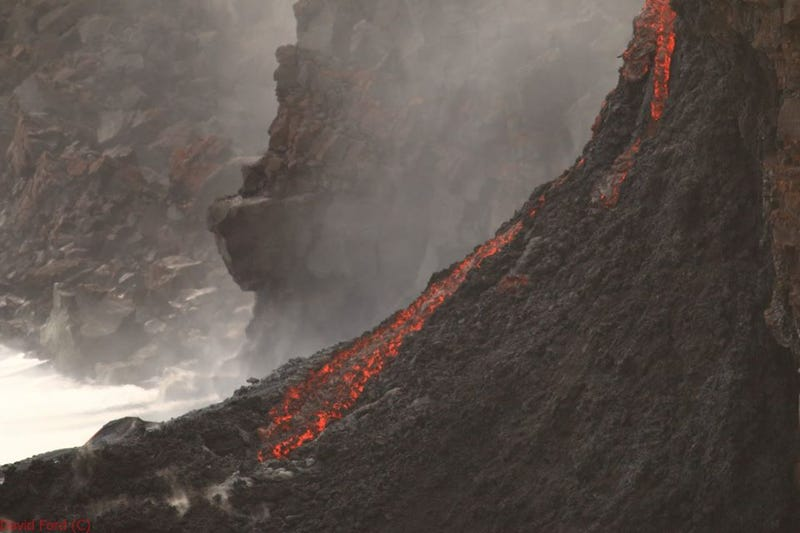 Watch Lava Spilling Over a Cliff into the Ocean