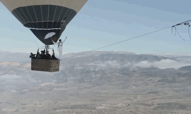 Holy crap: Guys try to walk a tightrope between two hot air balloons