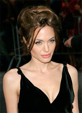 Either Angelina Jolie Is Subtly Disapproving Of The Murdoch-Dow Jones Deal Or She Doesn't Really Understand Freedom Of The Press