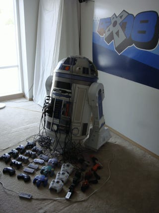 Awesome R2-D2 Houses Eight Game Consoles and Projector