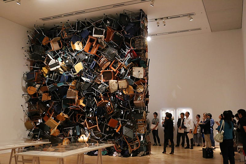 A Wall Made of 300 Chairs Takes Repurposing a Step Further