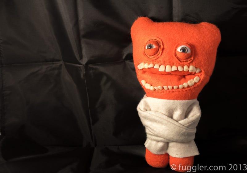 False teeth transform these cute felt toys into plushy horrors