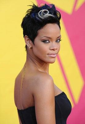 "Rihanna Says She's ""Doing Well""; TMZ Claims Police Photo Wasn't Stolen"