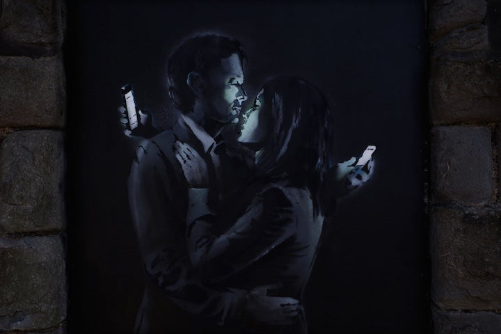 Banksy's New Piece is a Comment on Smartphones