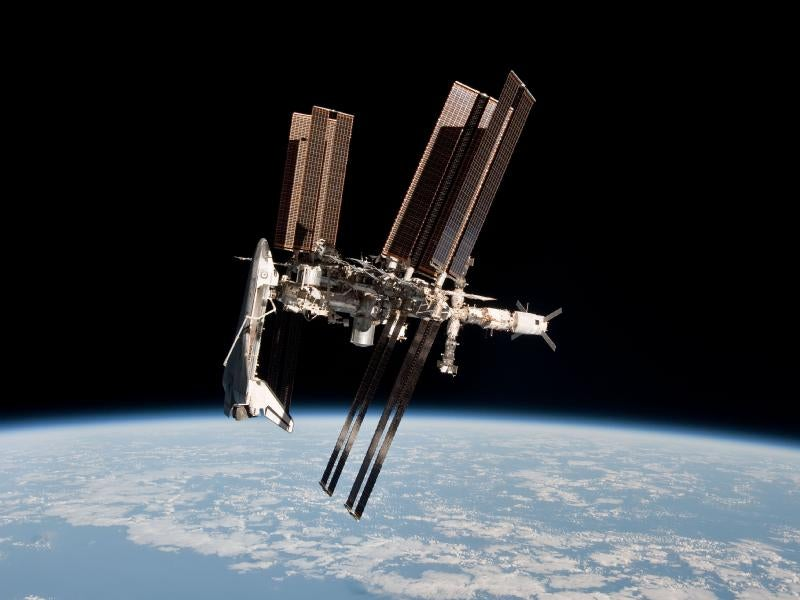 The first-ever photos of a space shuttle docked at the International Space Station
