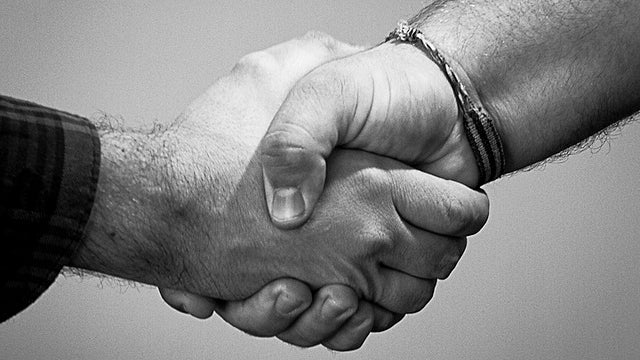 Keep Your Hand from Getting Crushed During a Handshake by Touching the Other Person's Wrist
