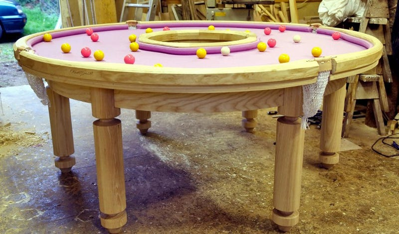 Homer Simpson Would Play For Hours on This Donut-Shaped Pool Table