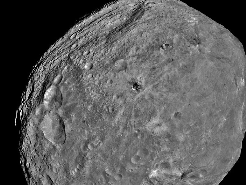 "First close-up photographs of giant asteroid Vesta reveal ""Snowman"""