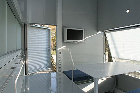 micro compact home trailer park living with that euro design flair. Black Bedroom Furniture Sets. Home Design Ideas