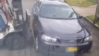 Forklift Driver Picks Up Car Parked In Way Of Delivery Driver