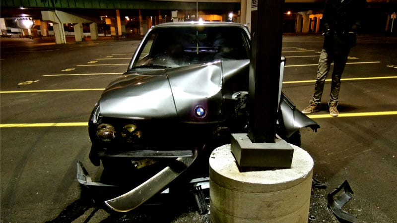 Watch A BMW Crash Into A Light Pole During Some Failed Parking Lot Hoonage