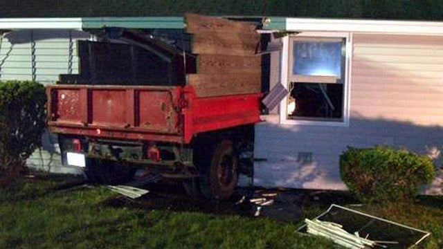 Naked man drives dump truck into a condo
