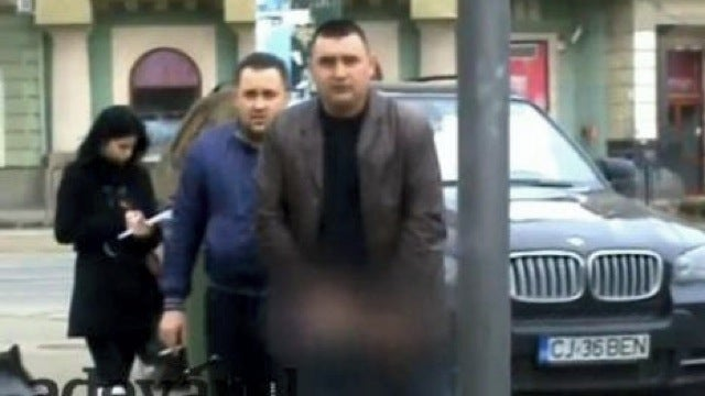 Romanian mobster gets parking ticket, flashes police