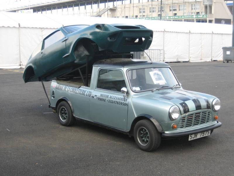 Here is a Mini pickup hauling a Mini Marcos bodyshell.