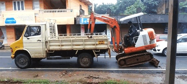 Watch This Indian Worker Load His Backhoe Into A Truck With No Ramp