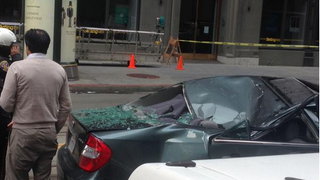 Window Washer falls 11 stories onto moving car, survives